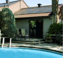 Solar water heating system for swimming pools